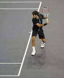 Roger Federer of Switzerland in actions. Roger Federer of Switzerland actions during an exhibition tennis match against James Blake of the U.S. in Kuala Lumpur Royalty Free Stock Photography