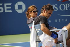 Roger and Mirka Federer. Tennis legend Roger Federer and his wife Mirka during his practice session at the 2013 US open tennis tournament Royalty Free Stock Image