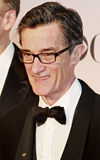 Roger Rees. Welsh-born actor Roger Rees sports his lapel pin signifying his nomination for Director for Peter and the Starcatcher, at the Meet the Nominees press Royalty Free Stock Photos
