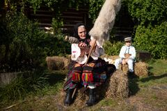 Free Rogoz, Romania, October 12th, 2019, Portraiture Of Woman Wearing Traditional In Maramures With Her Spindle For Distaff Royalty Free Stock Image - 170420306