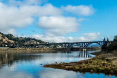 The Rogue River Bridge at Gold Beach, Oregon. An arched bridge crosses the Rogue River in Gold Beach, Oregon Royalty Free Stock Photo