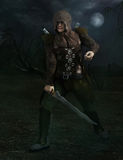 Rogue with sword. In forest with moonlight Royalty Free Stock Images