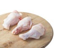 Rohe Hühnerbeine auf weißem Hintergrund Lizenzfreie Stockfotografie