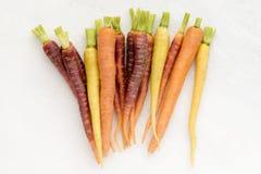 Rohe Regenbogen-Karotten Stockbilder