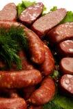 Rohe Würste und Gemüse Lizenzfreies Stockfoto
