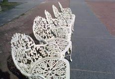 Roheisen-Patio-Stühle Stockbilder