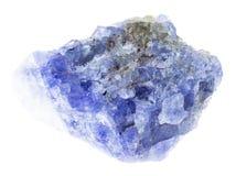 roher tanzanite Stein auf Weiß lizenzfreie stockfotos