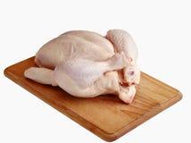 Rohes Huhn auf hölzernem Vorstand Lizenzfreies Stockfoto