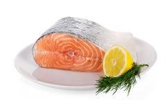 Rohes Steak von Lachsen auf Weiß Lizenzfreies Stockfoto