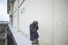 Rohingya Refugee in Aceh Shelter. A Rohingya Refugee in Aceh Shelter call their relatives in his hometown Stock Photos