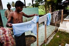 A Rohingya refugee was hanging clothes in a refugee camp. Immigration of Lhokseumawe city providing temporary infrastructure for Rohingya refugees before they royalty free stock images