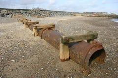 Rohr auf dem Strand Stockfotografie