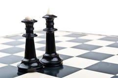 Roi et reine dans les échecs photographie stock