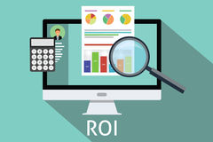 Roi return on investment. Computer calculator magnifying glass Royalty Free Stock Photography