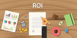 Roi return on investment concept with hand work  some paper document  graph chart and wooden table. Roi return on investment concept with hand work on some paper Royalty Free Stock Images