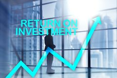 ROI - Return on investment. Stock trading and financial growth cocept on blurred business center background. ROI - Return on investment. Stock trading and stock photos