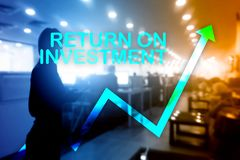 ROI - Return on investment. Stock trading and financial growth concept on blurred business center background.  stock photography
