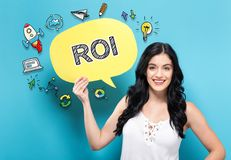 ROI with woman holding a speech bubble Stock Image