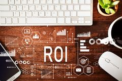 ROI with workstation. On a wooden desk Stock Images