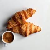 Сroissants, coffee espresso on white. Сroissants, espresso on white background for breakfast, lunch or coffee time Stock Photos