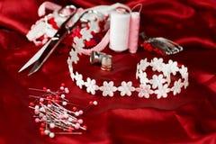 Rojo de costura Foto de archivo libre de regalías