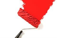 Rojo de la pintura del rodillo de pintura foto de archivo libre de regalías