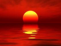 Rojo de la puesta del sol del océano Fotografía de archivo libre de regalías