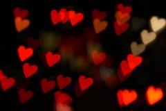 Rojo del bokeh de los corazones Imagen de archivo