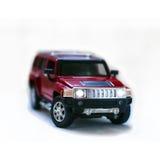 Rojo del coche del juguete del camino Fotos de archivo libres de regalías