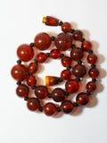 Rojo del collar en un fondo blanco Imagen de archivo libre de regalías