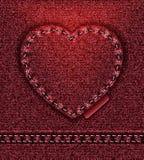 Rojo del corazón de los pantalones vaqueros   Imagenes de archivo