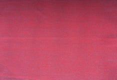 Rojo, escarlata, fondo marrón Foto de archivo libre de regalías