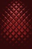 Rojo lujoso del fondo abstracto - entone los muebles de cuero de la textura Foto de archivo libre de regalías