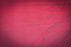 Rojo, marsala, escarlata, fondo marrón Foto de archivo libre de regalías