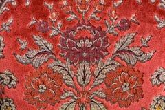 Rojo material prosperado Foto de archivo libre de regalías