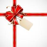 Rojo y arqueamiento del regalo del oro Fotografía de archivo libre de regalías