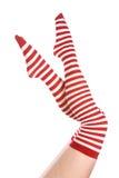 Rojo y blanco pega las piernas para arriba Imagen de archivo