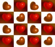 Rojo y modelo inconsútil del corazón del chocolate Fotos de archivo libres de regalías