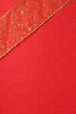 Rojo y regalo del oro Imágenes de archivo libres de regalías