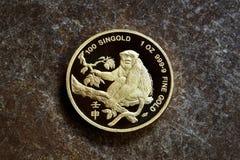 ` rok Małpi jeden ` złocistej sztaby uncjowa moneta Zdjęcie Stock