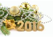2016 rok złote postacie i Bożenarodzeniowe dekoracje Zdjęcia Royalty Free