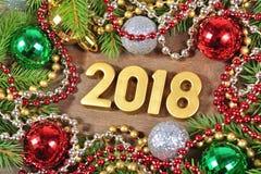 2018 rok złote postacie i Bożenarodzeniowe dekoracje Obraz Royalty Free
