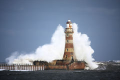 Roker Lighthouse Wave. Roker Lighthouse at Sunderland being hit by a large wave Royalty Free Stock Images