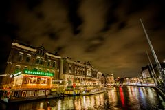 Rokin Amsterdam Boats at Night. Rokin is a canal and major street in Amsterdam, the Netherlands. Originally it was part of the river Amstel, and was known then Royalty Free Stock Images