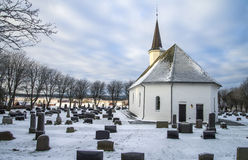 Rokke church in the winter (east). Rokke church is a church built in a rectangular form, from 1100 in Halden, Østfold county. The structure is of stone and has Royalty Free Stock Images