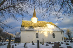 Rokke church in the winter (south). Rokke church is a church built in a rectangular form, from 1100 in Halden, Østfold county. The structure is of stone and has Stock Images
