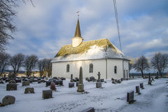 Rokke church in the winter (southeast). Rokke church is a church built in a rectangular form, from 1100 in Halden, Østfold county. The structure is of stone and Stock Photos