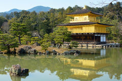 Rokuon-ji Temple of the Golden Pavilion reflecting in the surrounding pond garden in Kyoto, Japan. Temple of the Golden Pavilion, or Rokuon-ji, reflecting into Stock Image
