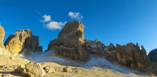 Roky cliff mountain pass of Dolomites long panoram. Roky cliff mountains of Dolomites yellow color at sunset. Dolomiti di Brenta, Italy, the Dolomites. Beautiful Stock Images