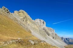 Roky cliff mountain pass of Dolomites. Roky cliff mountains of Dolomites yellow color at sunset. Dolomiti di Brenta, Italy, the Dolomites. Beautiful rocky peak Royalty Free Stock Photos